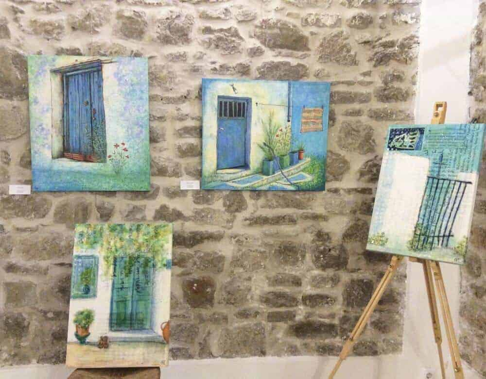 new mixed media paintings and giclee canvas reproductions by english artist gill tomlinson on display at an exhibition in Methoni, Greece