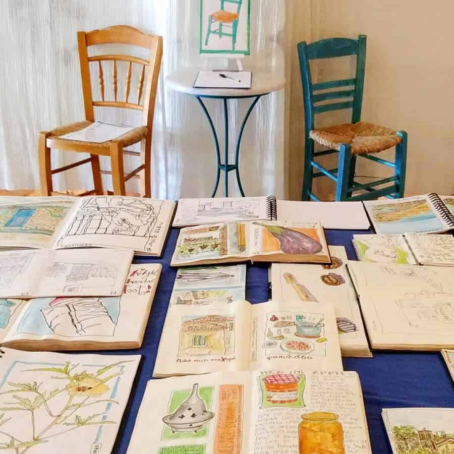 sketchbooks at art exhibition by gill tomlinson in Koroni, Greece