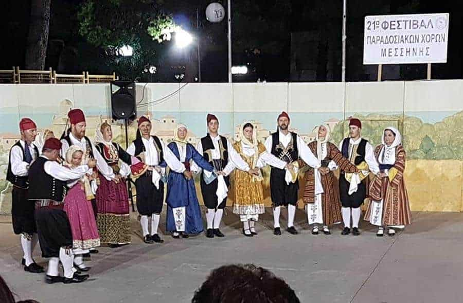 greek dancing roup in traditional costume